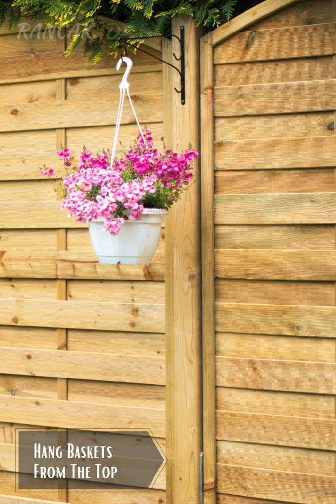 Hang Baskets From The Top of The Fence For Added Colour